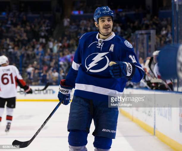 Brian Boyle of the Tampa Bay Lightning skates to teammates to celebrate a goal against the Ottawa Senators during the third period at Amalie Arena on...