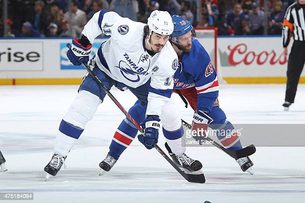 Brian Boyle of the Tampa Bay Lightning wins a faceoff against Dominic Moore of the New York Rangers in Game Seven of the Eastern Conference Final...