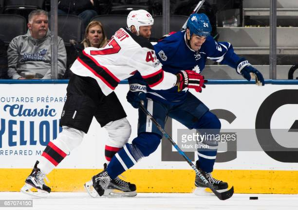 Brian Boyle of the Toronto Maple Leafs battles for the puck with Dalton Prout of the New Jersey Devils during the second period at the Air Canada...