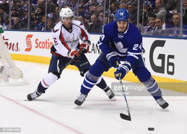 Brian Boyle of the Toronto Maple Leafs carries the puck away from Matt Niskanen of the Washington Capitals during the first period in Game Three of...