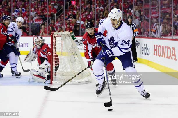 Brian Boyle of the Toronto Maple Leafs controls the puck against Kevin Shattenkirk of the Washington Capitals in the second period in Game Two of the...