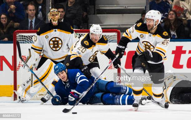 Brian Boyle of the Toronto Maple Leafs falls while battling Dominic Moore Riley Nash and Tuukka Rask of the Boston Bruins during the second period at...