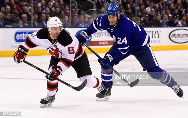 Brian Boyle of the Toronto Maple Leafs skates against Andy Greene of the New Jersey Devils during the second period at the Air Canada Centre on March...