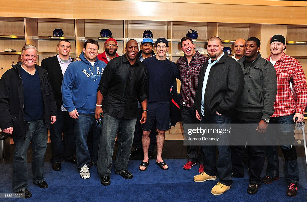 Brian Boyle poses with New York Giants players in the Rangers locker room after the Tampa Bay Lightning vs the New York Rangers game at Madison Square Garden on February 9, 2012 in New York City.