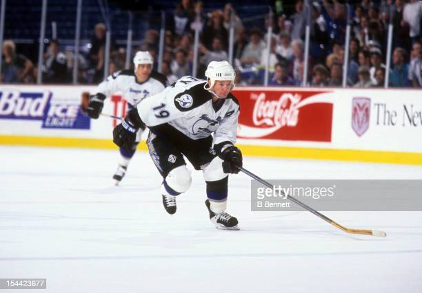 Brian Bradley of the Tampa Bay Lightning skates on the ice during an NHL game in February 1996 at the Thunderdome in St Petersburg Florida