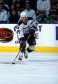 Brian Bradley of the Tampa Bay Lightning skates with the puck during an NHL game in December 1996 at the Thunderdome in St Petersburg Florida