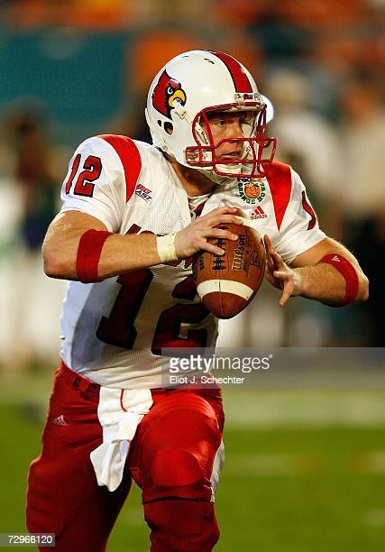 Brian Brohm of the Louisville Cardinals drops back against the Wake Forest Demon Deacons during the 2007 FedEx Orange Bowl at Dolphin Stadium on...