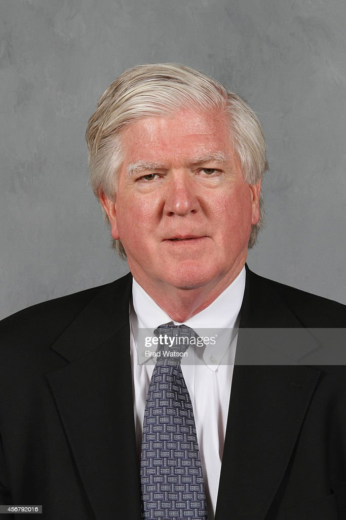 <a gi-track='captionPersonalityLinkClicked' href=/galleries/search?phrase=Brian+Burke&family=editorial&specificpeople=546491 ng-click='$event.stopPropagation()'>Brian Burke</a> of the Calgary Flames poses for his official headshot for the 2013-2014 season on September 12, 2013 at the WinSport Winter Sport Institute at Canada Olympic Park in Calgary, Alberta, Canada.