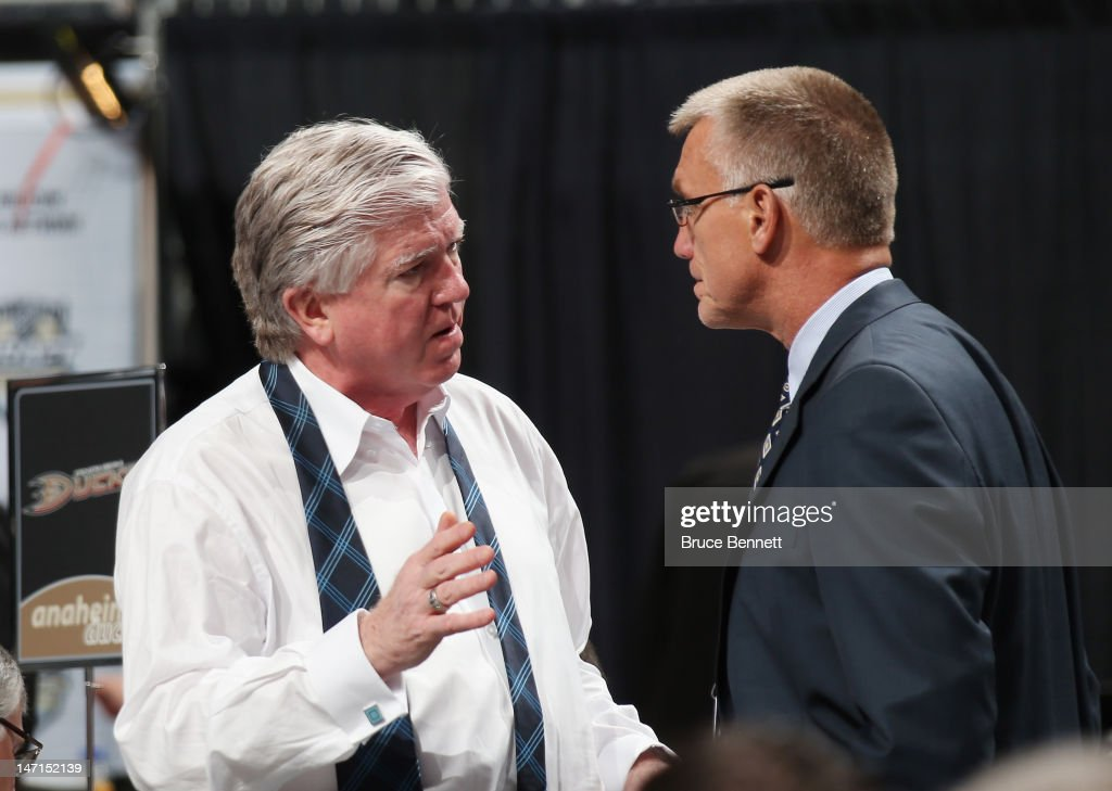 Brian Burke of the Toronto Maple Leafs and Paul Holmgren of the Philadelphia Flyers discuss matters on the draft floor during day two of the 2012 NHL Entry Draft at Consol Energy Center on June 23, 2012 in Pittsburgh, Pennsylvania.