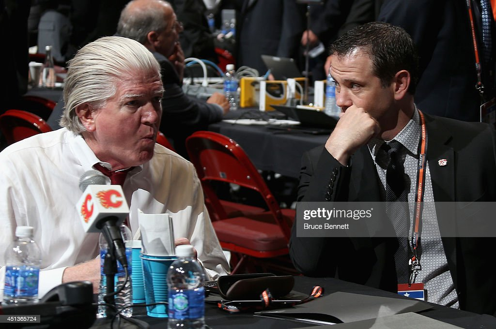 Brian Burke (L) President of Hockey Operations for the Calgary Flames, is seen prior to the start of the first round of the 2014 NHL Draft at the Wells Fargo Center on June 27, 2014 in Philadelphia, Pennsylvania.