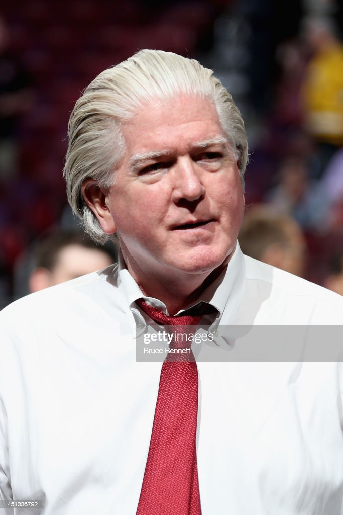 <a gi-track='captionPersonalityLinkClicked' href=/galleries/search?phrase=Brian+Burke&family=editorial&specificpeople=546491 ng-click='$event.stopPropagation()'>Brian Burke</a>, President of Hockey Operations for the Calgary Flames, looks on prior to the first round of the 2014 NHL Draft at the Wells Fargo Center on June 27, 2014 in Philadelphia, Pennsylvania.