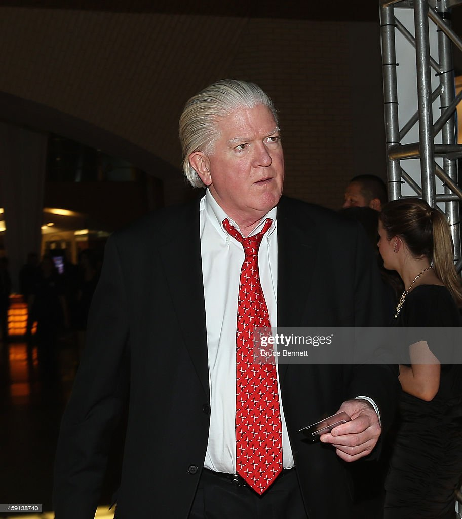<a gi-track='captionPersonalityLinkClicked' href=/galleries/search?phrase=Brian+Burke&family=editorial&specificpeople=546491 ng-click='$event.stopPropagation()'>Brian Burke</a> walks the red carpet prior to the induction ceremony at the Hockey Hall of Fame on November 17, 2014 in Toronto, Canada.
