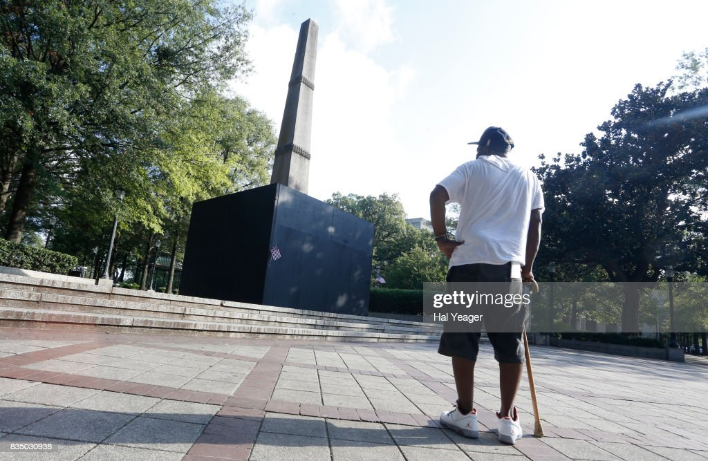 Brian Burrell pauses to look at a now covered confederate monument in Linn Park. on August 18, 2017 in Birmingham, Alabama. Alabamas attorney general Steve Marshall sued the city of Birmingham and the mayor for partially covering the Confederate monument with a wooden box, citing it violated the Alabama Memorial Preservation Act.