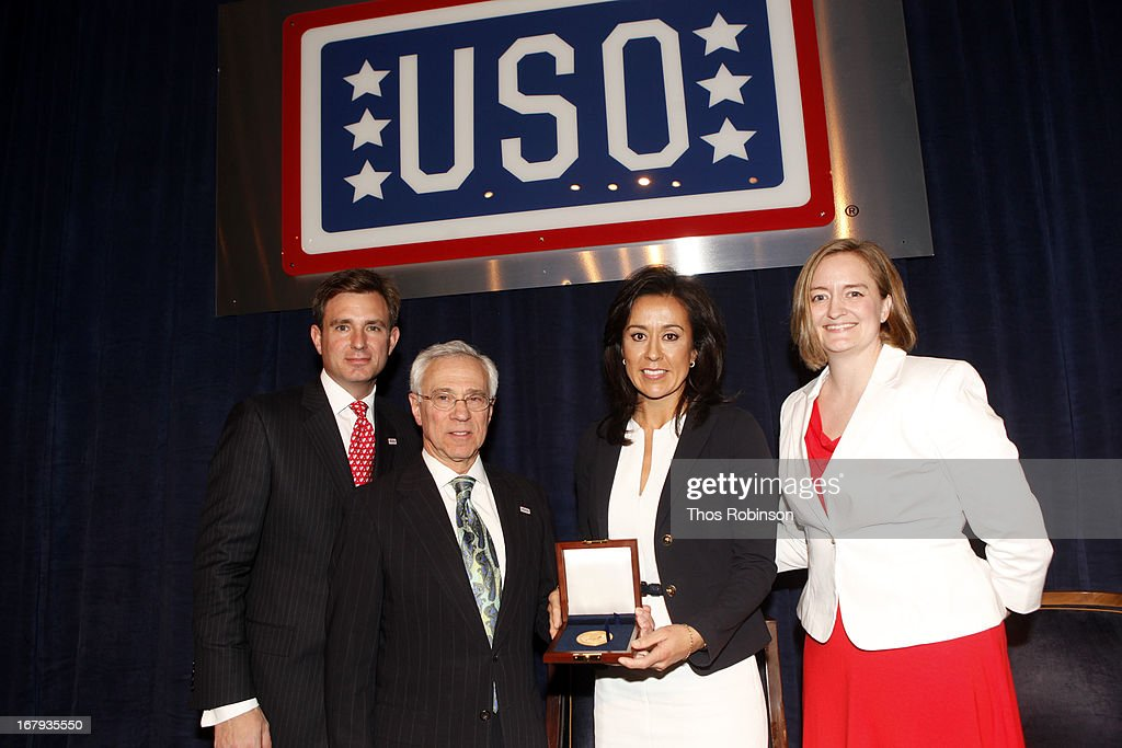 Brian C. Whiting, president and CEO of USO of Metropolitan New York, colonel Jack H. Jacobs, United States Army (Ret.) and medal of honor recipient, Gisel Ruiz, executive vice president & chief operating officer of Walmart, USA, and medal of honor recipient, and Jessica Crow, medal of honor recipient attend the USO Woman Of The Year Luncheon at The Pierre Hotel on May 2, 2013 in New York City.