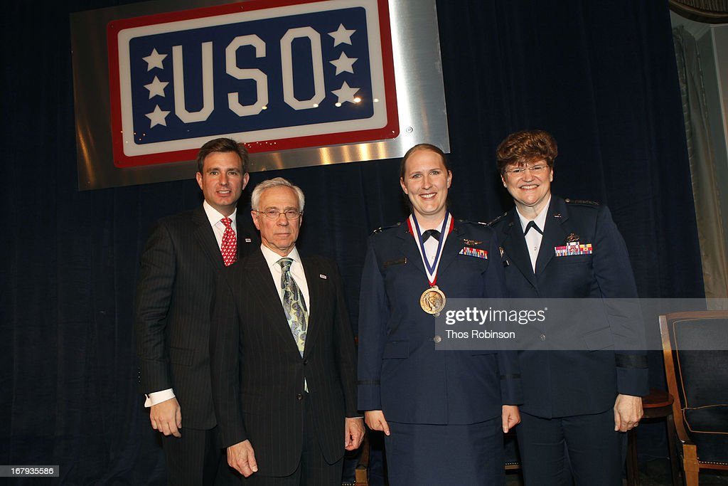 Brian C. Whiting, president and CEO of USO of Metropolitan New York, colonel Jack H. Jacobs, United States Army (Ret.) and medal of honor recipient, captain Holly Nelson, United States Air Force, and medal of honor recipient, and General Janet C. Wolfenbarger, commander, Air Force Material Command and medal of honor recipient attend the USO Woman Of The Year Luncheon at The Pierre Hotel on May 2, 2013 in New York City.