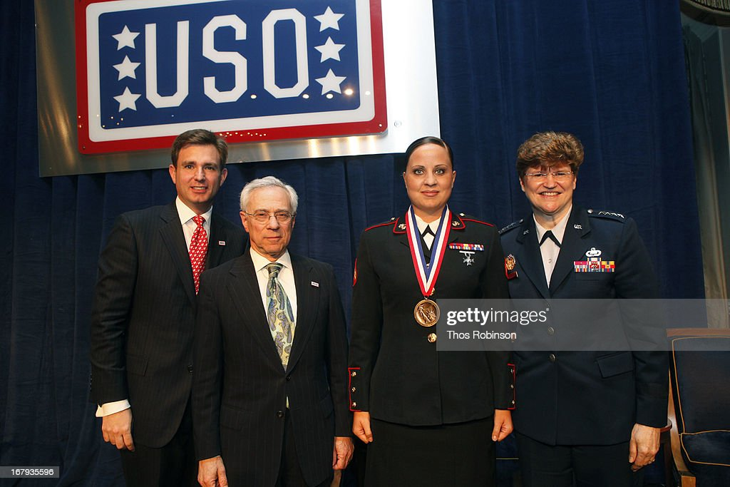 Brian C. Whiting, president and CEO of USO of Metropolitan New York, colonel Jack H. Jacobs, United States Army (Ret.) and medal of honor recipient, corporal Mary Beth Monson, United States Marine Corp, and medal of honor recipient, and General Janet C. Wolfenbarger, commander, Air Force Material Command and medal of honor recipient attend the USO Woman Of The Year Luncheon at The Pierre Hotel on May 2, 2013 in New York City.