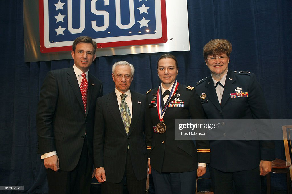 Brian C. Whiting, president and CEO of USO of Metropolitan New York, colonel Jack H. Jacobs, United States Army (Ret.) and medal of honor recipient, captain Helen Lily, United States Army, and medal of honor recipient, and General Janet C. Wolfenbarger, commander, Air Force Material Command and medal of honor recipient attend the USO Woman Of The Year Luncheon at The Pierre Hotel on May 2, 2013 in New York City.