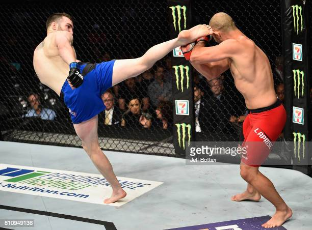 Brian Camozzi kicks Chad Laprise of Canada in their welterweight bout during the UFC 213 event at TMobile Arena on July 8 2017 in Las Vegas Nevada