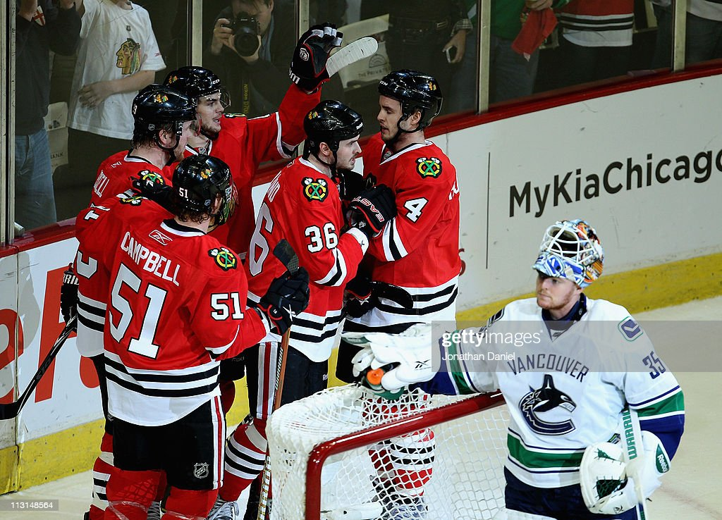 Brian Campbell Bryan Bickell Michael Frolik Dave Bolland and Niklas Hjalmarsson of the Chicago Blackhawks celebrate a 1st period goal against Cory...