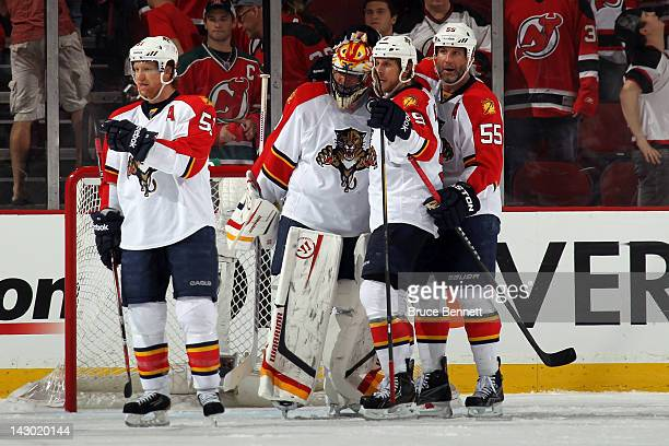 Brian Campbell goalie Scott Clemmensen Stephen Weiss and Ed Jovanovski of the Florida Panthers celebrate after they won 43 against the New Jersey...