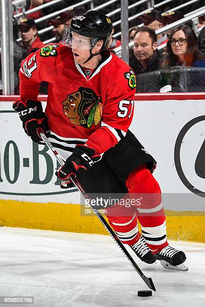 Brian Campbell of the Chicago Blackhawks approaches the puck in the second period against the Detroit Red Wings at the United Center on January 10...