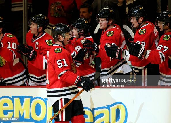 Brian Campbell of the Chicago Blackhawks celebrates a first period goal with teammates including Patrick Kane Bryan Bickell and Tomas Kopecky against...