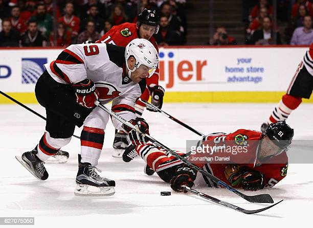 Brian Campbell of the Chicago Blackhawks dives to block a shot by Taylor Hall of the New Jersey Devils at the United Center on December 1 2016 in...