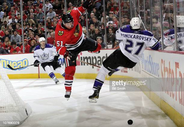 Brian Campbell of the Chicago Blackhawks jumps toward the puck during the game against the Los Angeles Kings on December 19 2010 at the United Center...