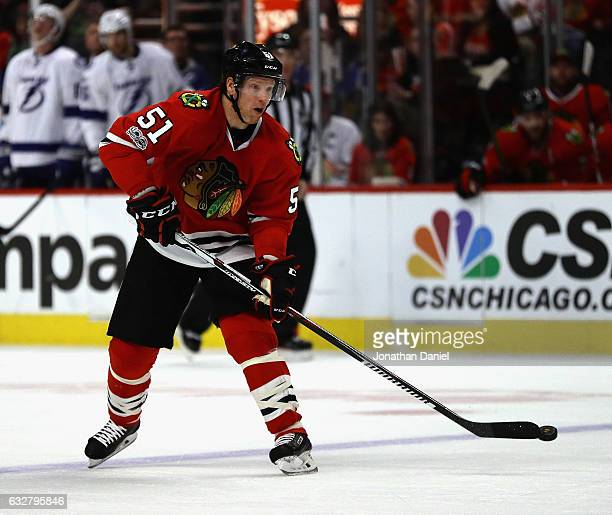 Brian Campbell of the Chicago Blackhawks passes against the Tampa Bay Lightning at the United Center on January 24 2017 in Chicago Illinois The...