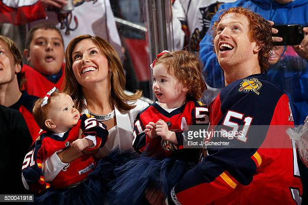 Brian Campbell of the Florida Panthers and family watch a video on the replay screen honoring him for his 1000th NHL game at the BBT Center on April...