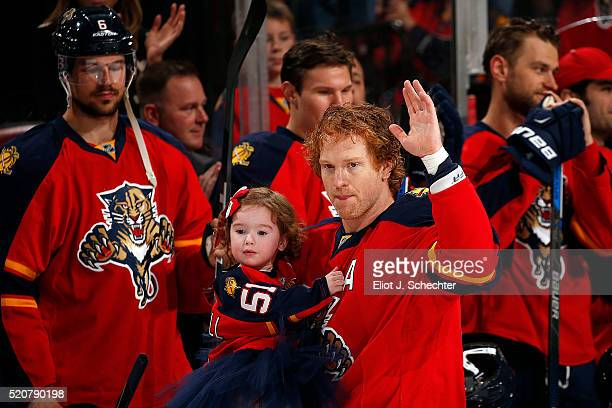 Brian Campbell of the Florida Panthers and his family walk out on the ice for a ceremony honoring his 1000th NHL game prior to playing the Carolina...