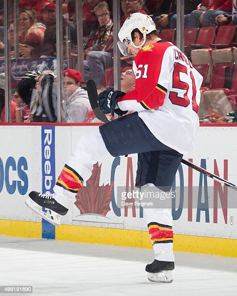 Brian Campbell of the Florida Panthers celebrates his game winning goal in overtime during an NHL game against the Detroit Red Wings at Joe Louis...