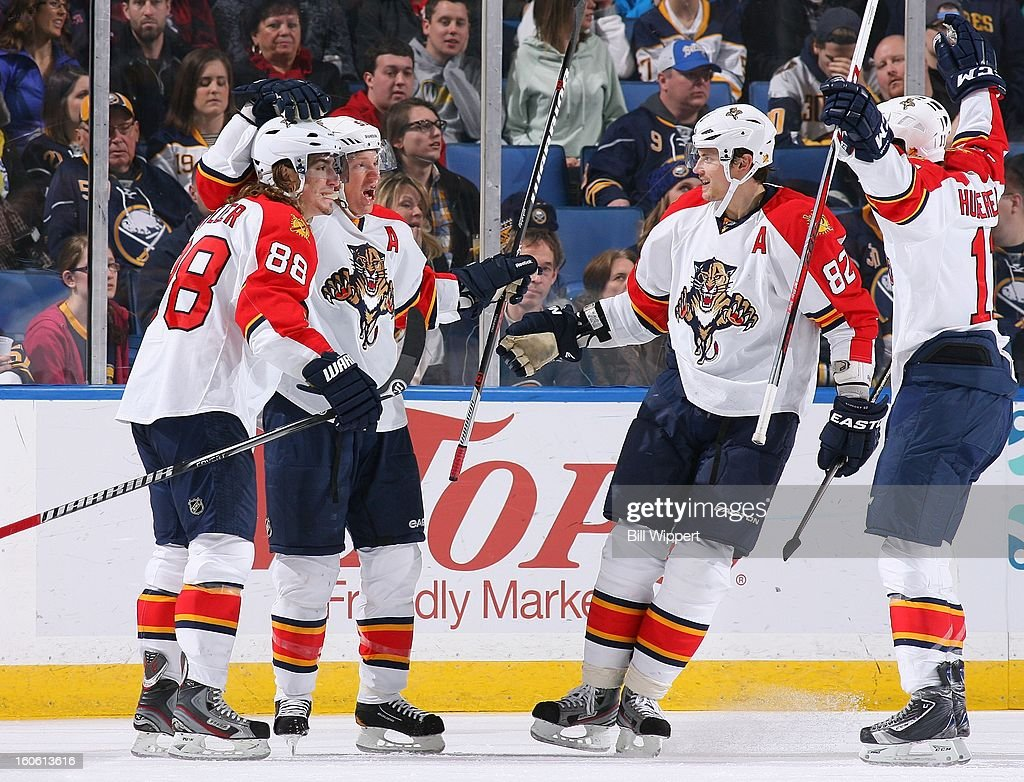 Brian Campbell #51 of the Florida Panthers celebrates his game-winning goal with teammates Peter Mueller #88, Tomas Kopecky #82 and Jonathan Huberdeau #11 against the Buffalo Sabres on February 3, 2013 at the First Niagara Center in Buffalo, New York. Florida defeated Buffalo, 4-3.