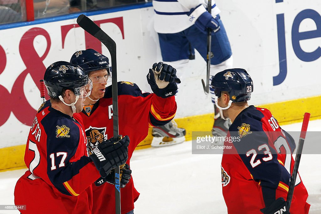 Brian Campbell #51 of the Florida Panthers celebrates his goal with teammates Jesse Winchester #17 and Scott Gomez #23 against the Toronto Maple Leafs at the BB&T Center on February 4, 2014 in Sunrise, Florida.