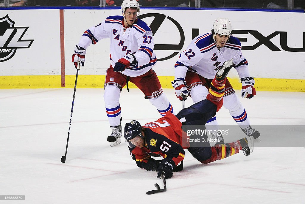 Brian Campbell #51 of the Florida Panthers goes after the puck as Brian Boyle #22 and Ryan McDonagh #27 of the New York Rangers follow during a NHL game at the BankAtlantic Center on December 30, 2011 in Sunrise, Florida.
