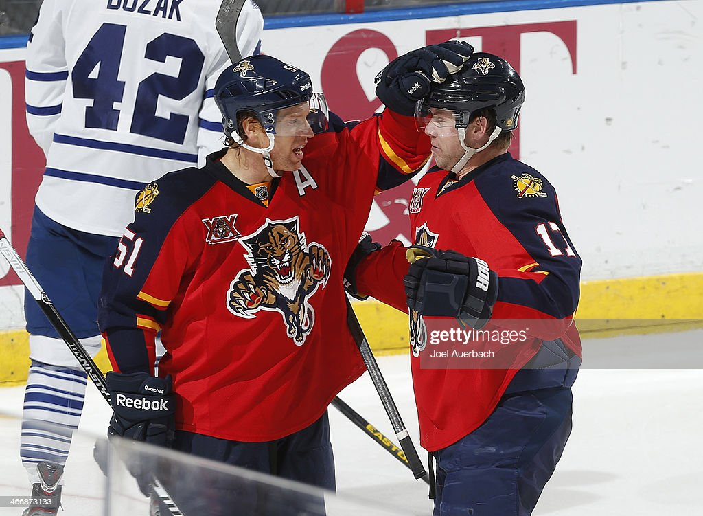Brian Campbell #51 of the Florida Panthers is congratulated by teammate Jesse Winchester #17 after scoring the second goal of the game against the Toronto Maple Leafs at the BB&T Center on February 4, 2014 in Sunrise, Florida. The Panthers defeated the Maple Leafs 4-1.