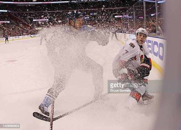 Brian Campbell of the Florida Panthers moves in to hit Kyle Turris of the Ottawa Senators at the BankAtlantic Center on March 4 2012 in Sunrise...