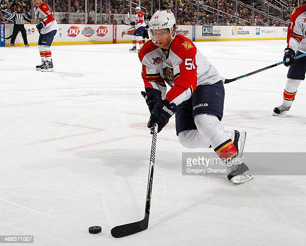 Brian Campbell of the Florida Panthers moves the puck against the Pittsburgh Penguins on January 20 2014 at Consol Energy Center in Pittsburgh...