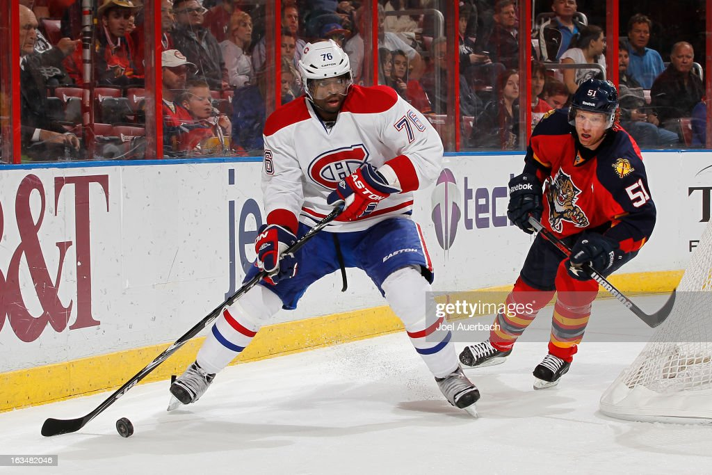 Brian Campbell #51 of the Florida Panthers pursues P.K. Subban #76 of the Montreal Canadiens as he attempts to center the puck in front of the net at the BB&T Center on March 10, 2013 in Sunrise, Florida. The Canadiens defeated the Panthers 5-2.