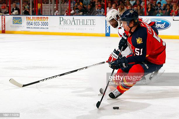 Brian Campbell of the Florida Panthers skates with the puck against Joel Ward of the Washington Capitals at the BBT Center on April 6 2013 in Sunrise...