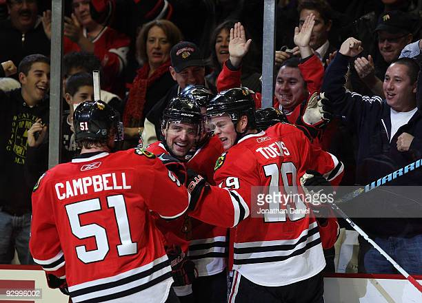 Brian Campbell Partick Sharp Patrick Kane and Jonathan Toews of the Chicago Blackhawks celebrate Kanes' first period goal against the Colorado...