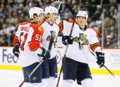 Brian Campbell Tomas Fleischmann and Filip Kuba of the Florida Panthers celebrate a second period goal against the Winnipeg Jets at the MTS Centre on...
