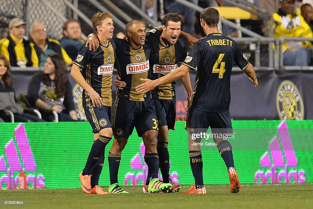 Brian Carroll #7, Fabinho #33 and Ken Tribbett #4, all of the Philadelphia Union, celebrate with Chris Pontius #13 of the Philadelphia Union after Pontius scored his second goal of the match against against the Columbus Crew SC in the second half on March 12, 2016 at MAPFRE Stadium in Columbus, Ohio. Philadelphia defeated Columbus 2-1.