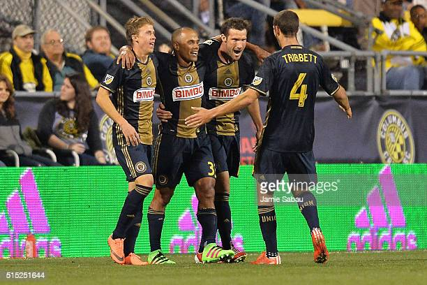 Brian Carroll Fabinho and Ken Tribbett all of the Philadelphia Union celebrate with Chris Pontius of the Philadelphia Union after Pontius scored his...
