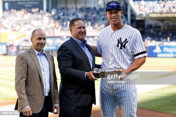 Brian Cashman general manager of the New York Yankees left and Damon Oppenheimer amateur scouting director of the New York Yankees center present...