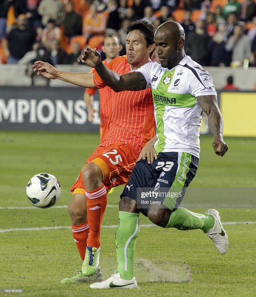 <a gi-track='captionPersonalityLinkClicked' href=/galleries/search?phrase=Brian+Ching&family=editorial&specificpeople=453218 ng-click='$event.stopPropagation()'>Brian Ching</a> #25 of Houston Dynamo and Felipe Baloy #23 of Santos Laguna battle for possession of the ball during the second half at BBVA Compass Stadium on March 5, 2013 in Houston, Texas.
