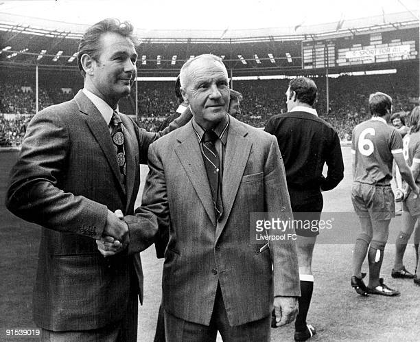 Brian Clough manager of Leeds United shakes hands with Bill Shankly manager of Liverpool before the FA Charity Shield match between Liverpool and...