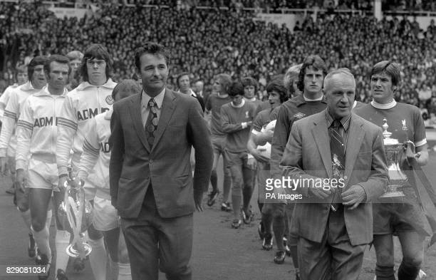 Brian Clough new manager of Leeds United and Bill Shankly retiring manager of Liverpool lead their men out for the FA Charity Shield match at Wembley...