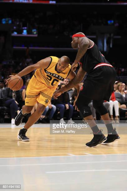 Brian Cook of the Killer 3s drives with the ball against Al Harrington of the Trilogy during week eight of the BIG3 three on three basketball league...