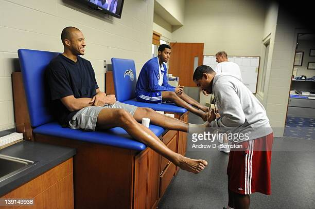 Brian Cook of the Los Angeles Clippers gets his ankle taped prior to the game against the Orlando Magic on February 5 2012 in Orlando Florida NOTE TO...